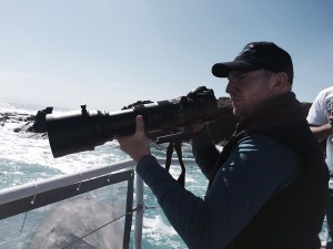 Chris Farrell photographing whales from a boat