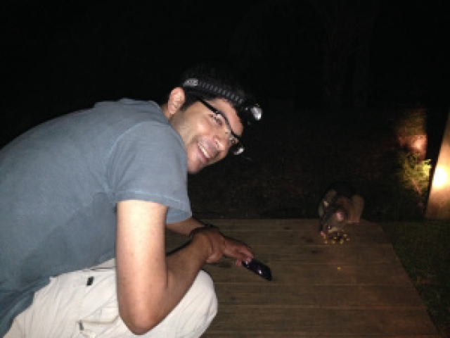 Aniket with a Brushtail Possum feeding on our verandah